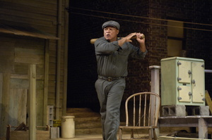 An actor plays the character Troy from the play Fences by August Wilson.